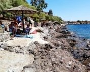 The rocky beach in Perdika on Aegina